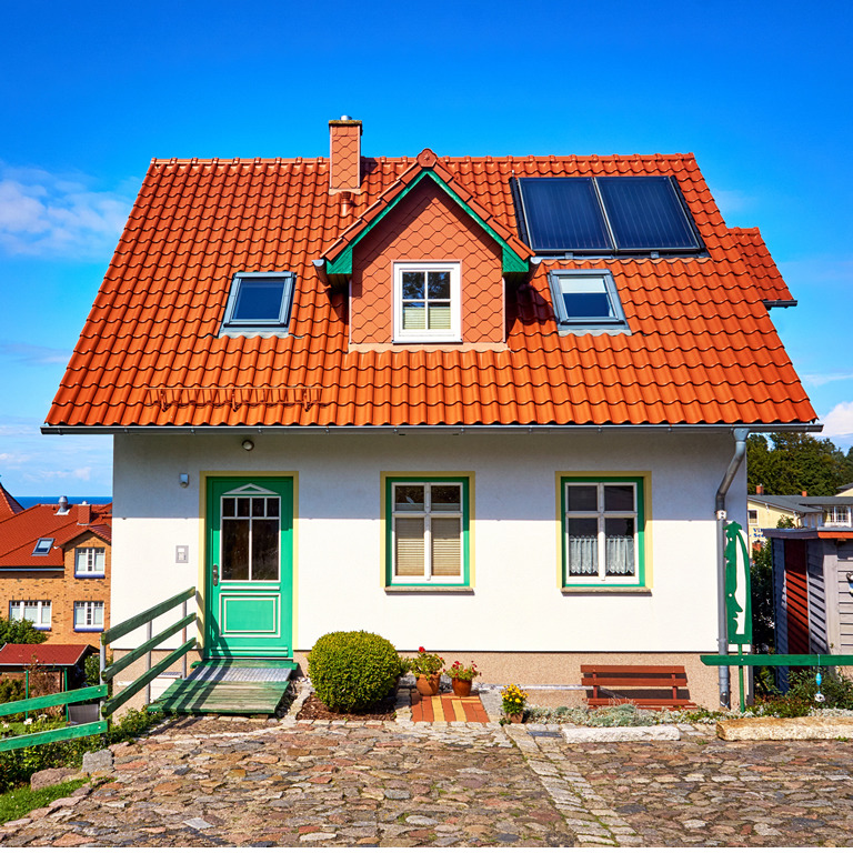 New modern single family house with red roof tiles and solar panels. Living overlooking the Baltic Sea in Lohme on the island of Rügen
